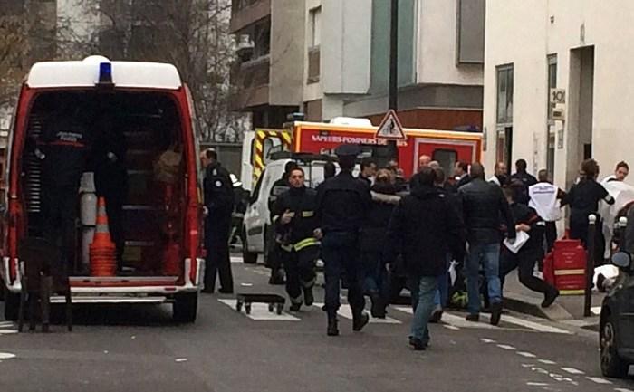Sediul ziarului Charlie Hebdo din Paris, 7 ianuarie, după atacul în care au fost omorâţi 11 oameni (Philippe Dupeyrat/AFP/Getty Images)