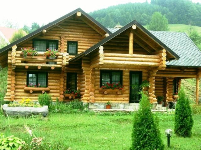 Proiectele de case din lemn rotund